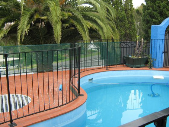 Wrought iron security fence is the most commonly installed fencing around our pools