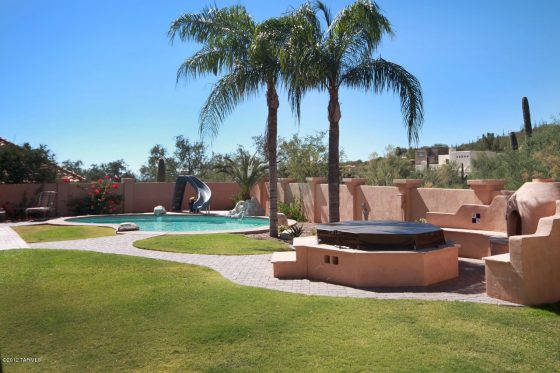 Install artificial grass or natural sod to complement your deck and pool