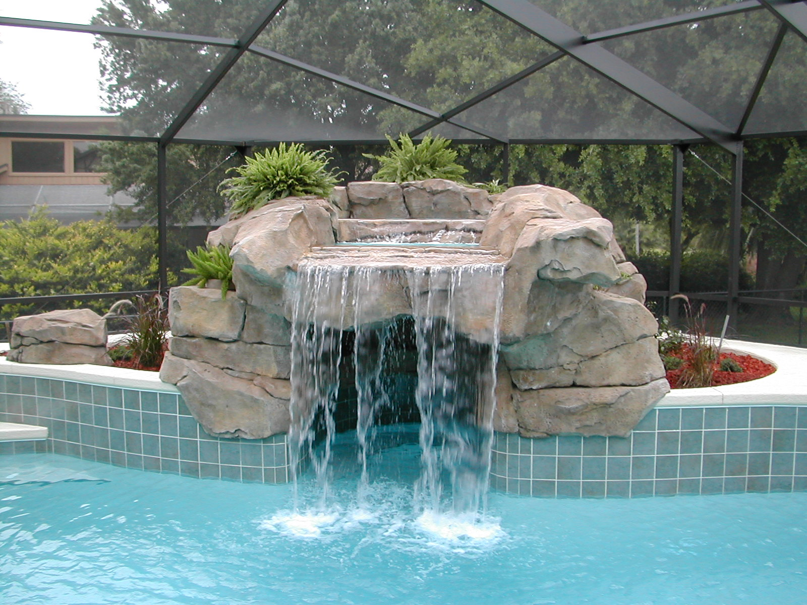 Water features omni pool builders design for Waterfall features